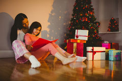 Mother and daughter waiting for santa claus Royalty Free Stock Photography