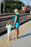 Mother and daughter waiting for train Stock Photos