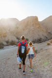 Mother and daughter walk through the desert active Royalty Free Stock Image