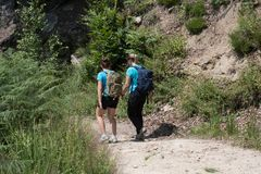 Mother and daughter walk while hiking in the mountains during th royalty free stock images