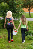 Mother and daughter walk home from the garden Stock Image