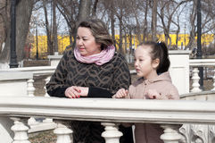 Mother with the daughter walk in the park. Royalty Free Stock Images