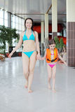 Mother and daughter walk after swimming Royalty Free Stock Photography