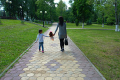 Mother and daughter on walk. Mother and daughter walking in the Park on a Sunny day Royalty Free Stock Photo