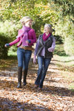 Mother and daughter on walk through woods Royalty Free Stock Images
