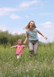 Mother and daughter walking Royalty Free Stock Photography