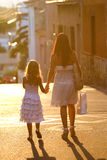 Mother and daughter walking Stock Images