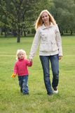 Mother and daughter walking Royalty Free Stock Image