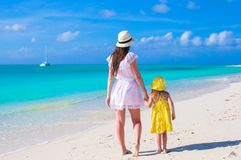 Mother and daughter walking along a tropical beach Royalty Free Stock Photography