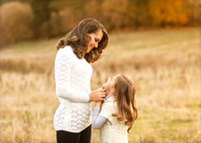 Mother and daughter walking in autumn in a field Royalty Free Stock Photography