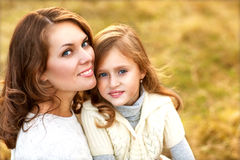 mother and daughter walking in autumn . Stock Photo