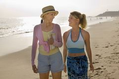 Mother and Daughter Walking on Beach Royalty Free Stock Photography