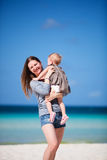 Mother with daughter walking on beach Stock Photography