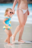 Mother and daughter walking at beach Royalty Free Stock Photography