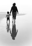 Mother and daughter walking on beach Royalty Free Stock Photo