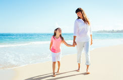 Mother and daughter walking on the beach Royalty Free Stock Photos
