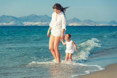 Mother and daughter walking on the beach Royalty Free Stock Photography
