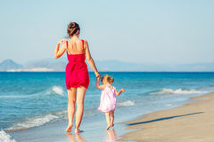 Mother and daughter walking on the beach Royalty Free Stock Images