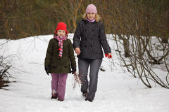 Mother and daughter walking in forest Royalty Free Stock Images
