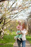 Mother and daughter walking in garden Royalty Free Stock Photos