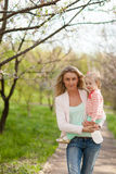 Mother and daughter walking in garden Royalty Free Stock Image