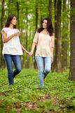 Mother and daughter walking hand in hand Royalty Free Stock Photos