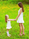 Mother and daughter walking and having fun together in summer Royalty Free Stock Images
