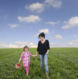 Mother and daughter in meadow Stock Photo