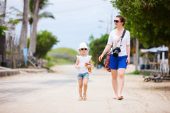 Mother and daughter walking outdoors Royalty Free Stock Photo