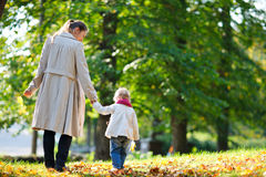 Mother and daughter walking in park Stock Image