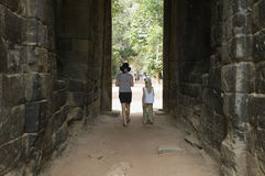 Mother And Daughter Walking Through Passage In Ancient Building Stock Image