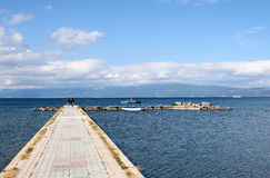 Mother and daughter walking on pier Ohrid lake Royalty Free Stock Images