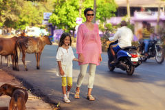 Mother and daughter walking on road Stock Image