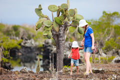 Mother and daughter walking at scenic terrain Royalty Free Stock Photography