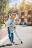Mother and daughter walking on street Royalty Free Stock Photos