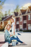 Mother and daughter walking on street Royalty Free Stock Photo