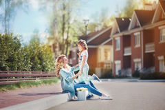 Mother and daughter walking on street Stock Image