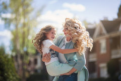 Mother and daughter walking on street Royalty Free Stock Images