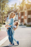 Mother and daughter walking on street Stock Photos