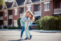 Mother and daughter walking on street Stock Photography