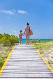 Mother and daughter walking to the beach Stock Image