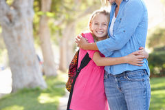 Mother And Daughter Walking To School On Suburban Street Royalty Free Stock Image