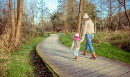Mother and daughter walking together holding hands Royalty Free Stock Photography