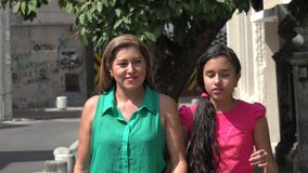 Mother and Daughter Walking on Urban Street stock video footage