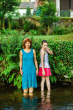 Mother with daughter walking in a village Royalty Free Stock Photos