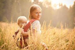 Mother and daughter walking in wheat Royalty Free Stock Photography