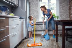 Mother daughter wash the floor at home Royalty Free Stock Images