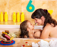 Mother and daughter  washing in bath. Royalty Free Stock Images