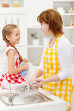 Mother and daughter washing the dishes Royalty Free Stock Image