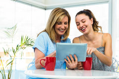 Mother and daughter watch tablet Stock Image